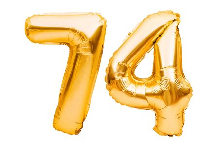 Number 74 seventy four made of golden inflatable balloons isolated on white. Helium balloons, gold foil numbers. Party decoration, anniversary sign for holidays, celebration, birthday, carnival.