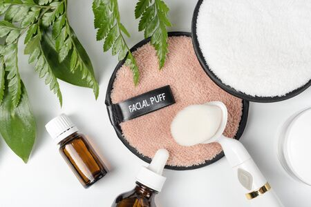 Organic bio cosmetics with herbal ingredients. Natural extract, oil, serum with fresh leaves. Flat lay, handmade beauty and spa, perfume or cream ingredients. Beauty, skin, hair or body care concept