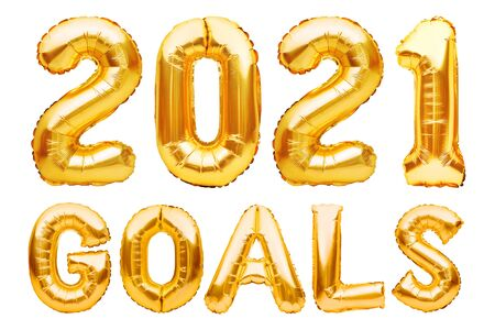 2021 GOALS phrase made of golden inflatable balloons. New year resolution goal list, change and determination concept. Helium balloons foil letters and numbers, celebration decoration. Imagens
