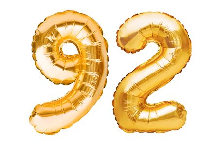 Number 92 ninety two made of golden inflatable balloons isolated on white. Helium balloons, gold foil numbers. Party decoration, anniversary sign for holidays, celebration, birthday, carnival Imagens - 150070141