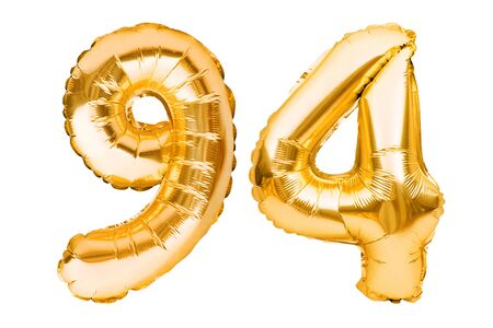 Number 94 ninety four made of golden inflatable balloons isolated on white. Helium balloons, gold foil numbers. Party decoration, anniversary sign for holidays, celebration, birthday, carnival