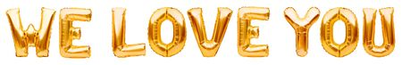 Golden words WE LOVE YOU made of inflatable balloons isolated on white background. Gold foil helium balloon letters, love message, balloons lettering Zdjęcie Seryjne