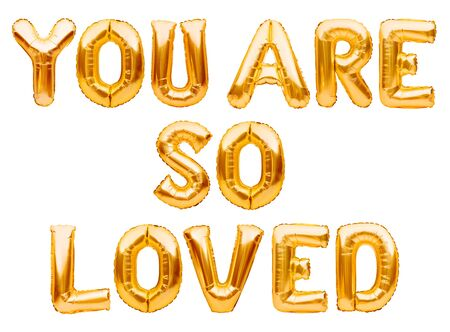 Golden words YOU ARE SO LOVED made of inflatable balloons isolated on white background. Gold foil helium balloon letters, love message, balloons lettering