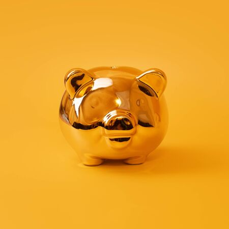 Golden piggy bank on yellow background. Money saving, money box, finance and investments concept Imagens - 150083226