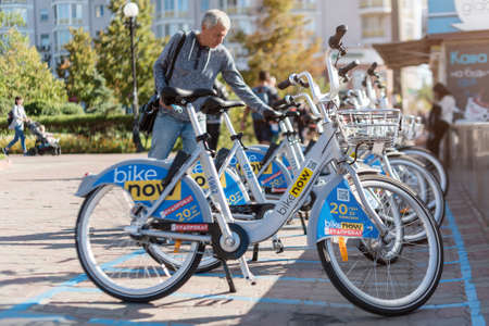 Kyiv, Ukraine - September 09, 2020: Rental bicycles of company Bike now. Ukrainian bike rental on special parking spaces. Bicycle-sharing system, public bicycle scheme or public bike share.