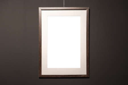 Empty frame on black wall. Blank space poster or art frame waiting to be filled. Black Frame Mock-Up Imagens