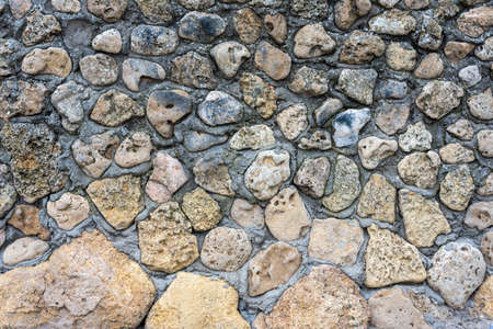 Texture of a stone wall. Old castle stone wall background. Wall made of wild stone. Natural background