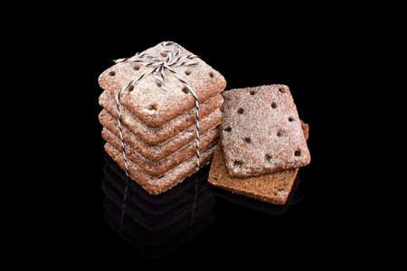 Freshly baked homemade bread isolated on black. Fresh chocolate rye bread biscuits. Healthy eating and traditional bakery, baking bread concept.