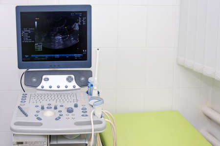Interior of examination room with ultrasonography machine in hospital laboratory. Modern medical equipment background