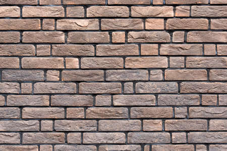 Brown brick wall texture. Grungy brickwall. Exterior or loft style bricks texture background