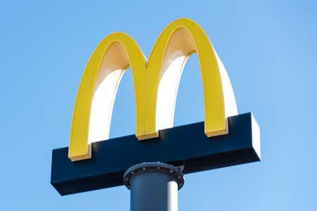 Kyiv, Ukraine - March 06: McDonald's restaurants logo in the blue sky. The McDonald's Corporation, the world's largest chain of fast food restaurants Redakční