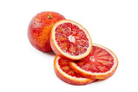 Bloody oranges whole and sliced isolated on white background. Red sicilian orange fruit