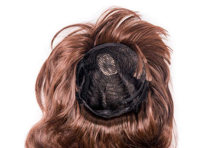 Female chocolate brown wig isolated on white background. Golden brown human hair weaves, extensions and wigs. Woman beauty concept. Imagens