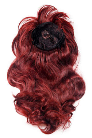Female long curly red wig isolated on white background. Red hair weaves, extensions and wigs. Hairstyle, haircut or dying in salon. Woman beauty concept. Imagens