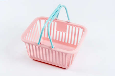 Colorful plastic shopping basket. Empty pink and blue supermarket basket on light background. Creative minimalist design, online shopping. Black friday and sale concept