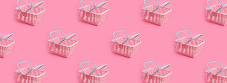 Pattern with pink plastic shopping basket on pink pastel background. Creative minimalist design. Black friday, discount, advertising and sale concept. Trendy minimal design art for poster, branding Imagens