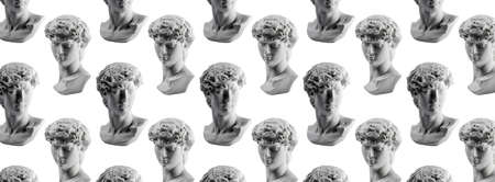 Pattern from gypsum statue of Davids head. Michelangelos David statue plaster copy isolated on white background. Ancient greek sculpture, statue of hero, banner