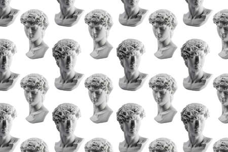 Pattern from gypsum statue of Davids head. Michelangelos David statue plaster copy isolated on white background. Ancient greek sculpture, statue of hero. Imagens