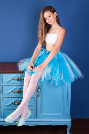 Teenage girl wearing ballet tutu skirt. Young ballerina dancer.