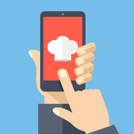 hand holding: Chef hat icon on smartphone screen. Hand holding black smartphone. Online recipes, cooking tutorials concepts. Modern elements. Flat design vector illustration