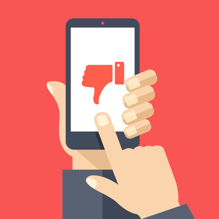 cellphone in hand: Hand holding smartphone with red dislike on screen. Social network and media on mobile phone. Modern graphic elements. Flat design vector illustration Illustration
