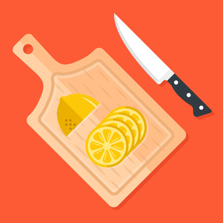 Lemon slices on kitchen cutting board and kitchen knife. Food ingredients, cooking, food preparation concept.