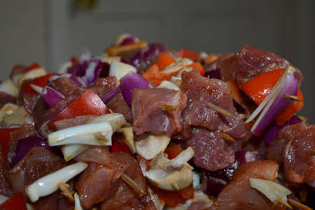 Meat with onion and vegetables photo