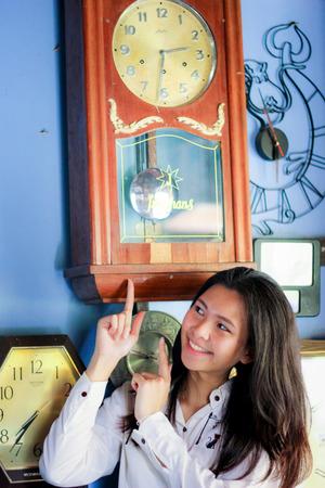 bib: girl in red bib with watch