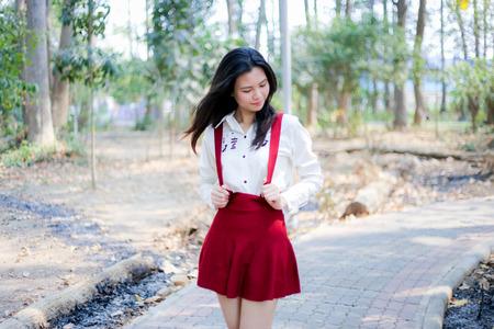 bib: girl in red bib at park Stock Photo