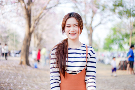 perfect smile: outdoor portrait  asian girl  with perfect smile at the park Stock Photo