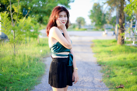 perfect smile: outdoor portrait asian women with perfect smile at the park Stock Photo