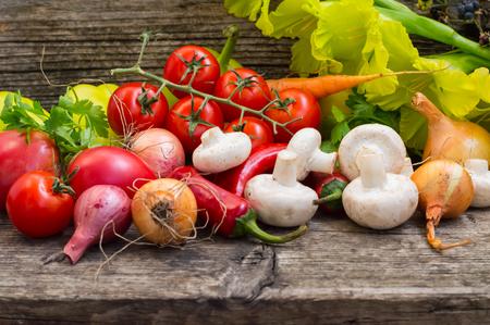 Vegetable set on a wooden background. Close-up