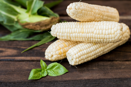 Fresh cobs of corn on the wooden background Stock fotó