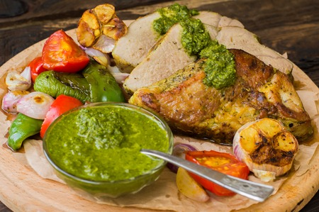 Meat with vegetables, grilled and served with Italian Salsa Verde sauce.