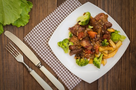 Stifado - a traditional Cypriot dishes, spread in Greece. It consists of a stew with tomatoes, potatoes, broccoli, onions, garlic and spicy spices Stock Photo