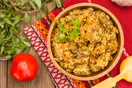 Uzbek pilaf - a dish consisting of rice and meat. At the traditional wooden background