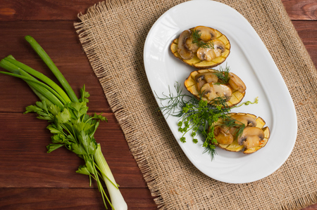 oily: Baked potatoes with fried mushrooms. Top view Stock Photo