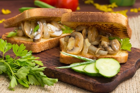 Toast with fried mushrooms and vegetables
