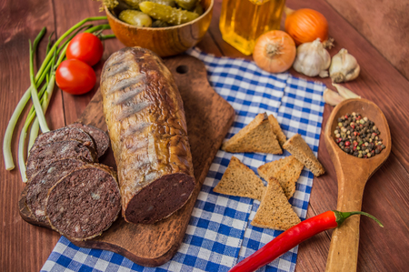 offal: Homemade blood sausage with offal on the old wooden background in rustic style. top view Stock Photo