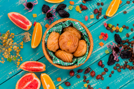 fat food: Custard pastries with coffee and sweets with different fruits. Cute and fabulous breakfast. Turquoise wooden background.
