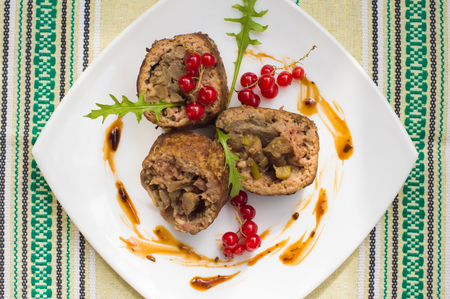 meatloaf: Meatloaf stuffed with mushrooms with sauce and berries. Rustic background