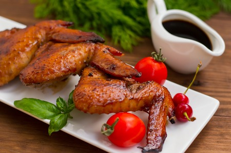 Marinated chicken wings in Japanese. On a wooden table. Stock Photo
