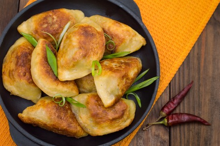 polish chicken: Fried dumplings in the pan. Wooden background Top view Stock Photo