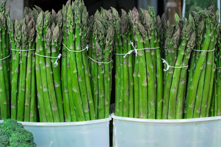 Fresh Asparagus on market. Top view. Close-up