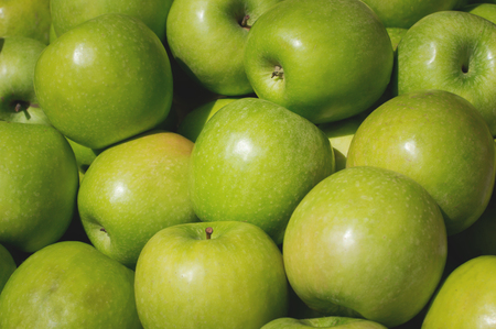 Green Apple for sale on market. Agriculture background. Close-up. Top view