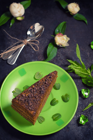 Cake with chocolate, honey and mint. Black background. Close-up. Top view Stock Photo