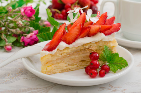 Napoleon cake with strawberries. Wooden background. Close-up. Top view