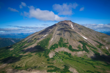 lenticular: Kamchatka. Wild nature. Green fields and volcanoes