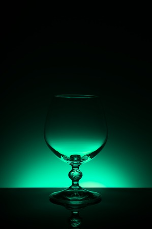 Wineglass on a color background with a black vignette