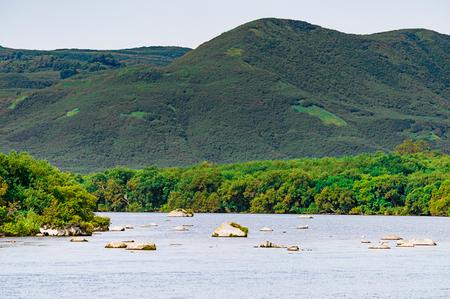 Kurile lake. Kamchatka. Russia. Green fields and volcanoes. Wild nature